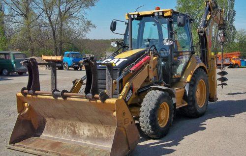 traktorbagr-caterpillar-428E1